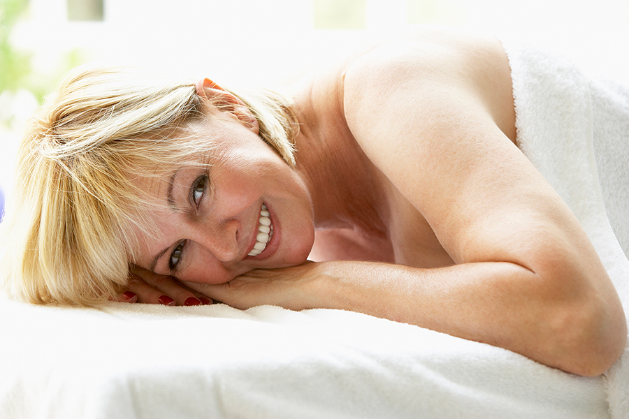 Middle Aged Woman Relaxing On Massage