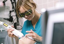Woman having laser skin treatment